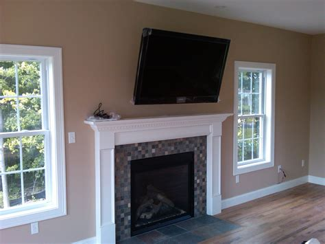 tv above fireplace tv over fireplace installation home theater installation