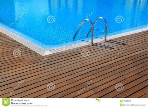 pool floor blue swimming pool with teak wood flooring royalty free stock images image 19400449