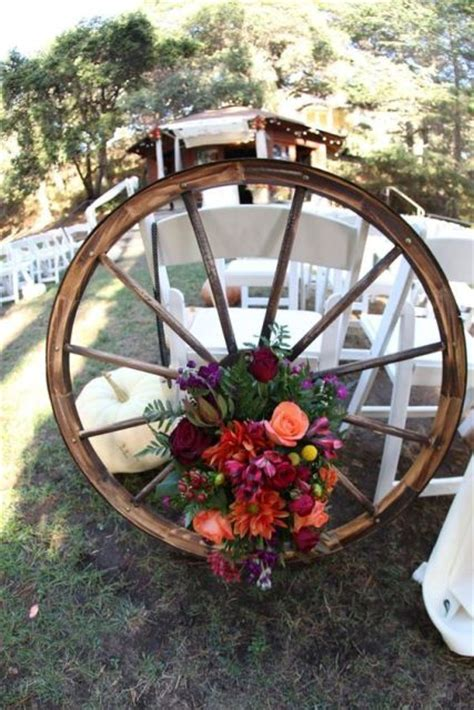 Pictures Of Wedding Wagons For Flower by Picture Of Floral Wagon Wheel For Wedding Decor
