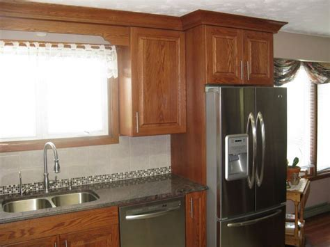 kitchen design with oak cabinets and stainless steel pin by jan surette on kitchen pinterest