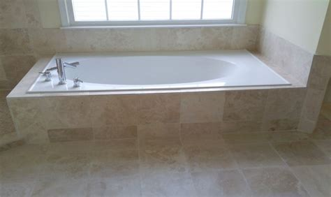 pictures of tile around bathtub travertine tile and frameless glass enclosure