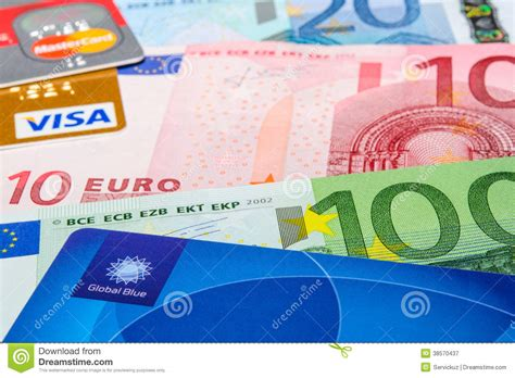Euro Visa Gift Card - global blue visa and mastercard credit cards on euro banknotes editorial photography