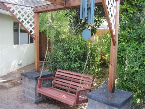 standing porch swing hanging wooden swings photos jbeedesigns outdoor the