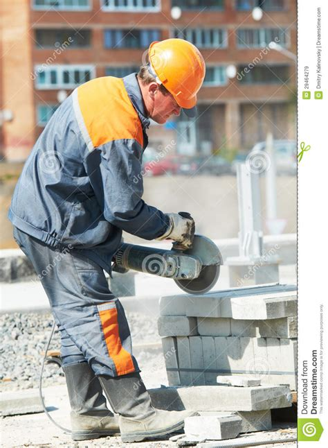 construction workers haircut builder at cutting curb work royalty free stock images