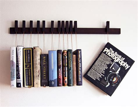 hanging book rack hang em and read em technabob