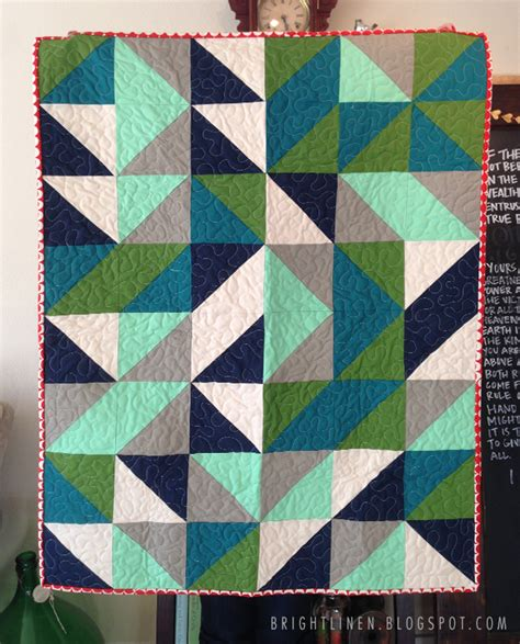 pattern for triangle baby quilt bright linen tutorial fat quarter half square triangle