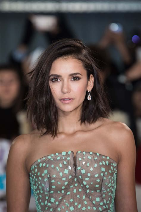 nina dobrev just chopped off all of her hair