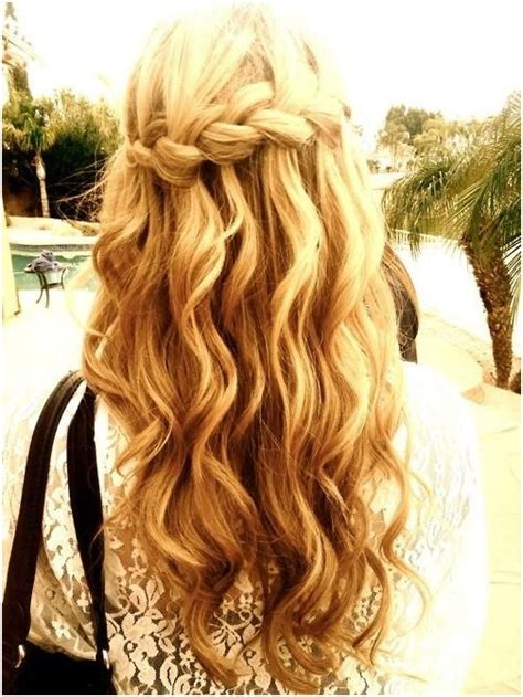 blonde hairstyles braids waterfall braid in long wavy hair blonde hairstyles