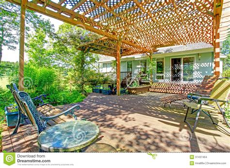 Green Architecture House Plans by Backyard Farm Deck With Attached Open Pergola Stock Photo