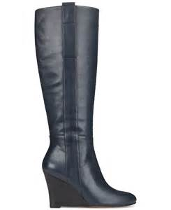 nine west oran tall wedge boots in blue navy leather lyst