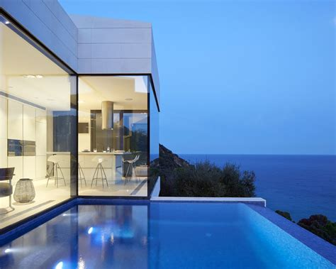 modern coastal house seaside oceanside modern hillside coastal home in spain with magnificent