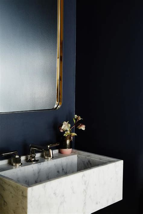 wall mounted marble sink navy blue powder room with marble vanity and gold sink