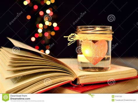now is the time for dreams books candle and books dreams magic stock photo image