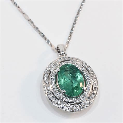 14k white gold emerald and pendant shown with