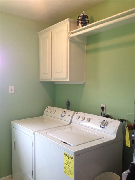 laundry room cabinets with hanging rod installation of cabinets and cloth hanging rod in laundry