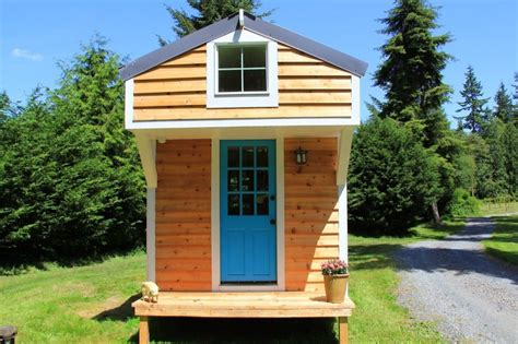 garage door tiny house 144 sq ft diy blue door tiny house on wheels