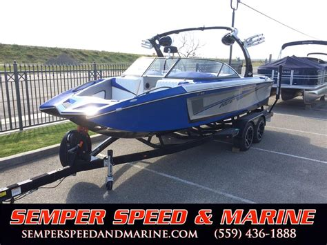boats with raptor engines 2016 tige rz2 surf boat pacific blue indmar 6 2l raptor