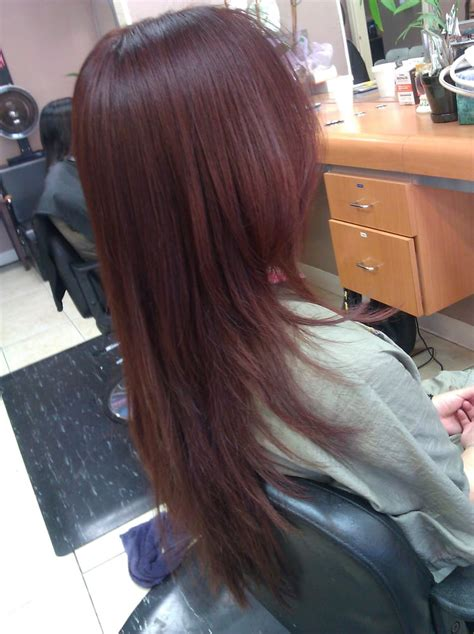 long hair with extreme layers v shaped haircut on extremely thick coarse and long hair