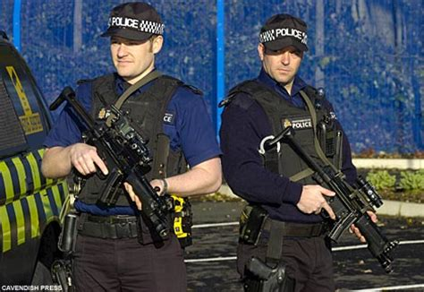 Armed Security Officer by Armed With Machine Guns To Protect Security Vans