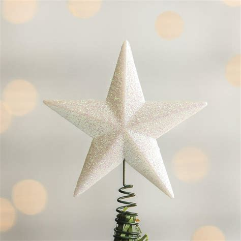 small white iridescent star tree topper christmas trees