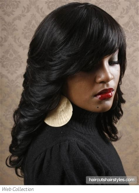 Hairstyles Black Long Hair | long flipped out black hair style
