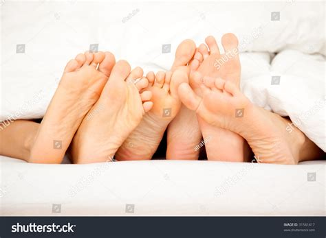 bed feet feet lying bed stock photo 31561417 shutterstock