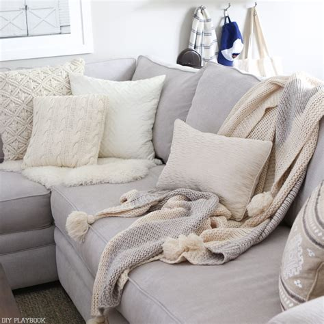 Sofa With Throw Pillows by How To Choose The Best Throw Pillows For A Gray