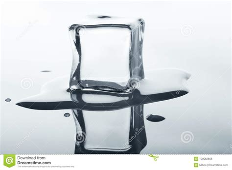 Block L Appears To Be A Melting Cube by Melting Cube With Reflection On White Stock Photo
