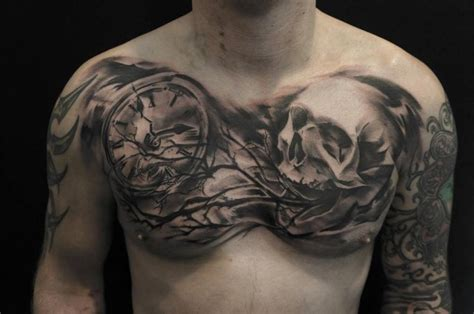 skull chest tattoos for men black ink skull with clock on chest