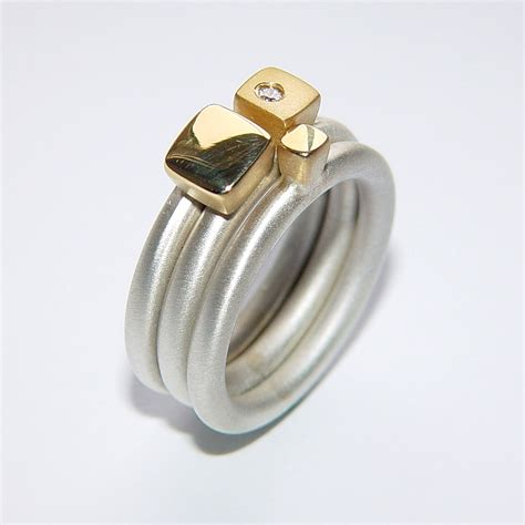 silver ring set with square gold detail