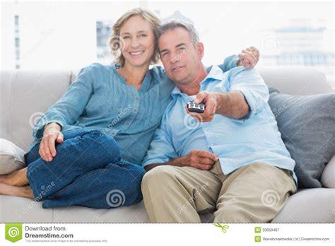 how to cuddle on a couch happy couple cuddling and sitting on the couch watching tv
