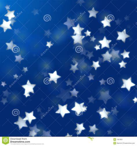 imagenes de luces blancas estrellas blancas en azul con las luces de la pluma stock