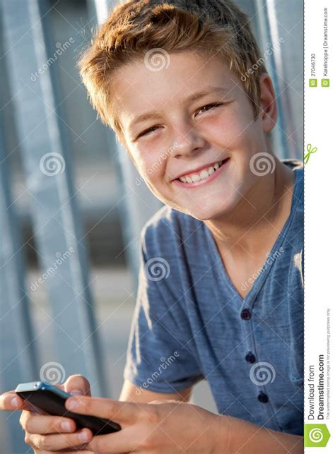 close up portrait of cute young boy stock image image close up portrait of boy with phone outdoors stock photo