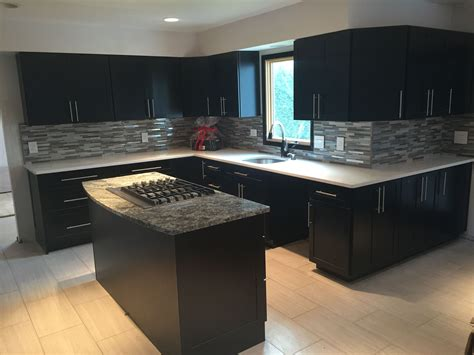 Black Glass Countertops by Modern Black And White Kitchen We Installed Kitchen
