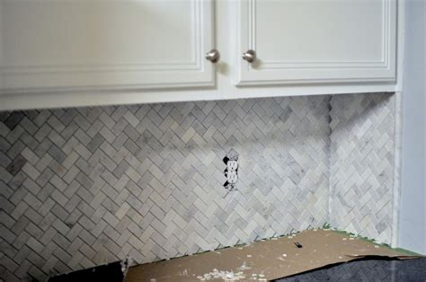 herringbone pattern carrara marble backsplash kitchens