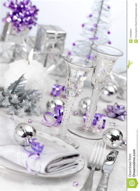 purple silver themed table setting stock photo image