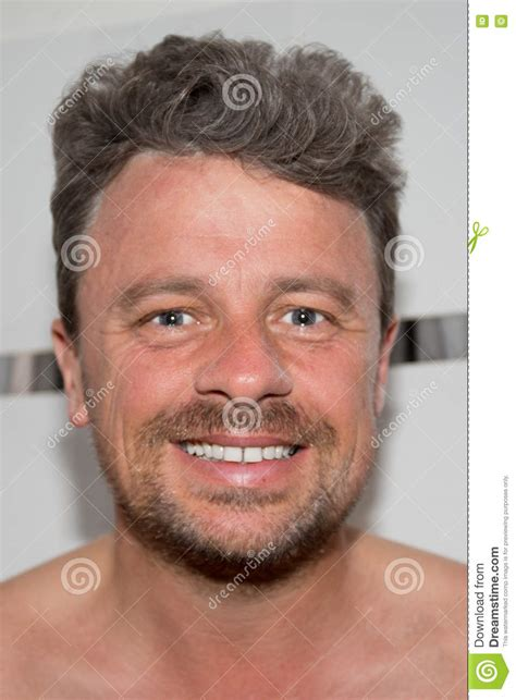 how can a 50 year old man look younger portrait d homme de 50 ans attirant photo stock image