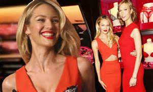 Candice Swanepoel holds lacy push up bra over her chest