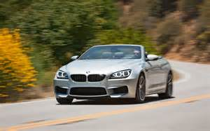 2013 bmw m6 convertible front three quarters in motion photo 9