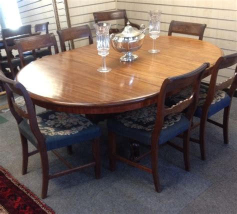 antique mahogany extending pull out dining table on turned