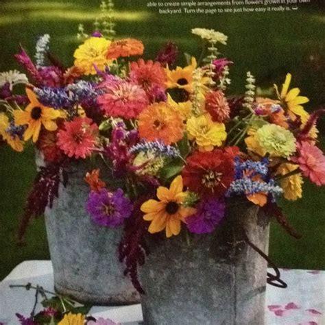 tin buckets for centerpieces outdoor wedding flowers in tin buckets for centerpiece or