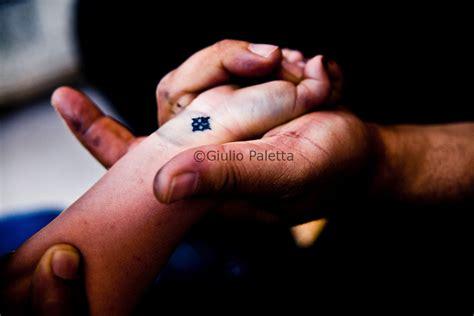 coptic cross tattoo on the wrist christian tattooer just finished tattooing a boy