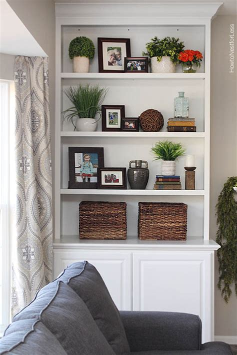how to decorate built in shelves styled family room bookshelves how to nest for less