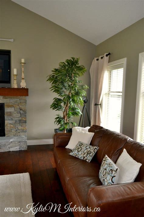 living room benjamin gray mirage with slate fireplace and cherry wood floors