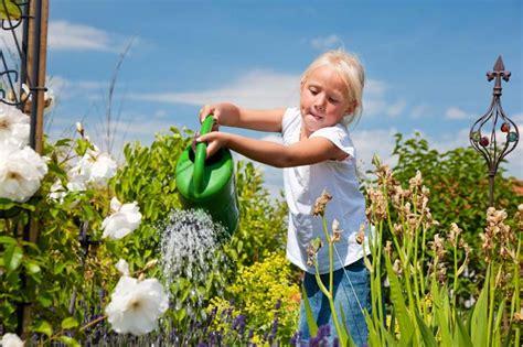Girl Watering Flowers | how to design a child s garden gardener s path