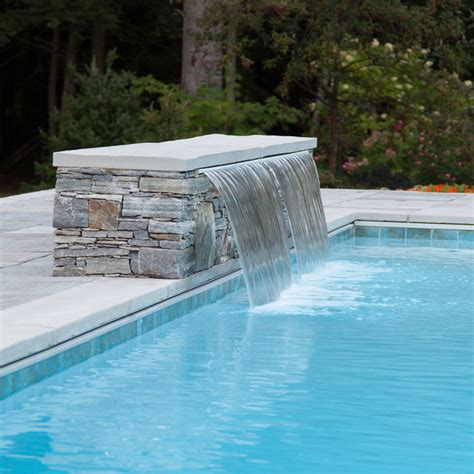 how to build a waterfall into a pool double cascading waterfall into pool with bench underwater