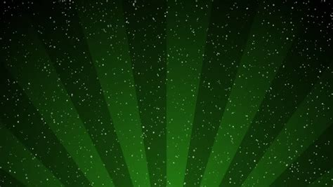 wallpaper deep green snow falls slowly over a deep green abstract gradient in