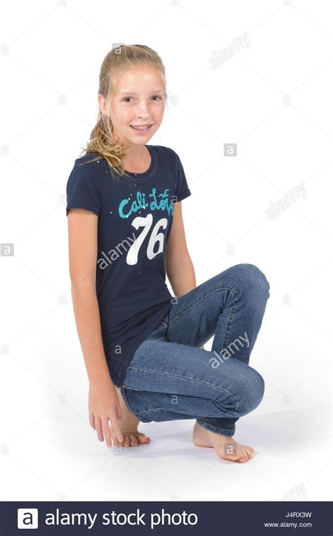 preteen girl with white feathers stock image image of preteen girl with blond hair and freckles wearing blue