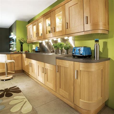lime green kitchen cabinets lime green l shaped kitchen curves soften the look of an l