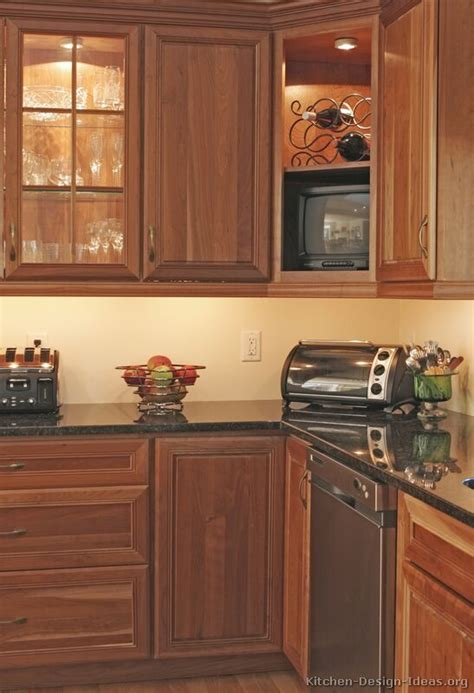 kitchen cabinet tv pictures of kitchens traditional medium wood golden brown kitchen 10